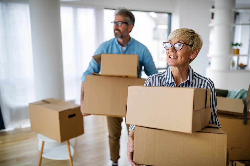 Senior couple moving boxes into Providence House Assisted Living