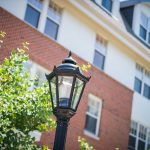 Photo of Providence House grounds where you can Schedule a Tour at Providence House, We have old styled lampposts and brickwork, the perfect recipe for an Active Senior Community