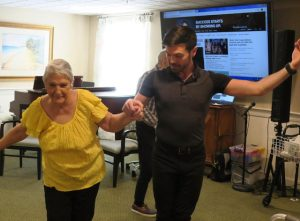 Active senior woman dancing with Michael J. Winward at Providence House Assisted Living in Brighton, MA