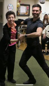 Michael J. Winward dancing with an active senior woman at Providence House Assisted Living in Brighton, MA